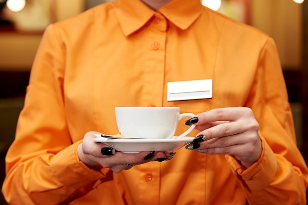 Service staff with a cup of coffee. Premium Photo