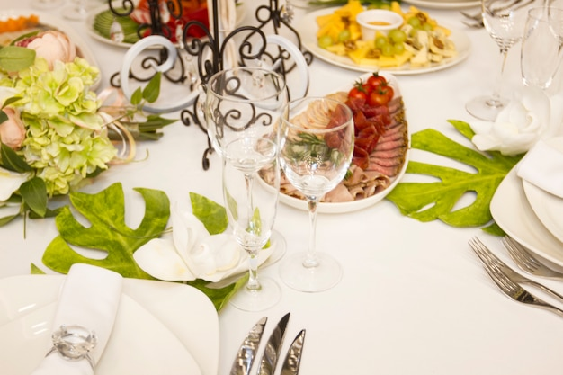 Serving dinner, wedding feast. beautifully designed dãƒâ©cor and delicious food. wedding table Premium Photo