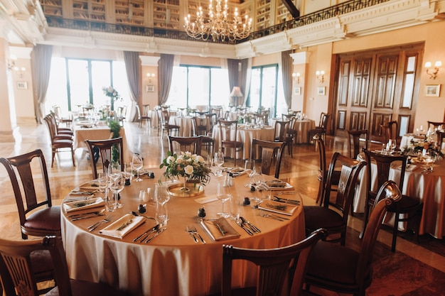 Serving tables for wedding in old restaurant Free Photo