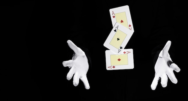 Set of aces playing card in mid-air between the magician hands Free Photo