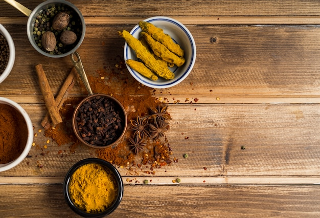 Set of aromatic spices on table Free Photo