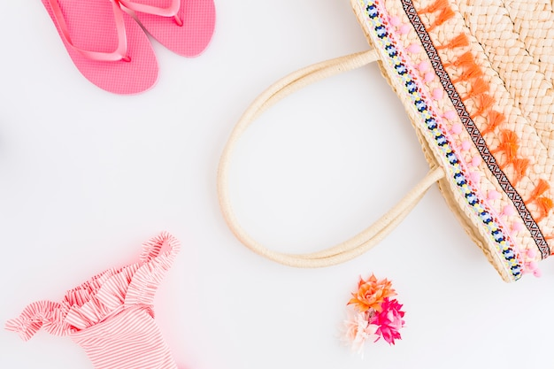 Set of beach vacation accessories on white background Free Photo