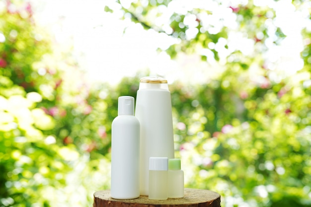 Set of body skin care products on nature, copy space. shampoo, gel, oil Premium Photo