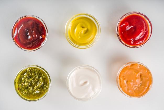 Set bowls of various dip and sauces Premium Photo