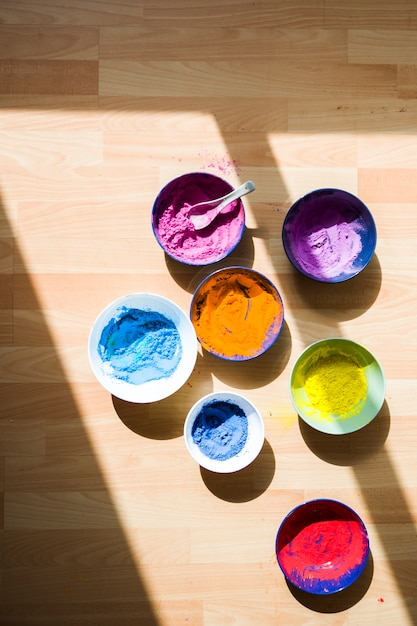 Set of bowls with different bright dry colors on floor Free Photo
