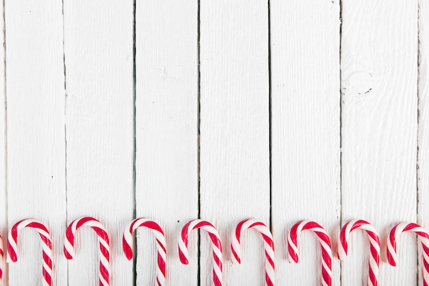 Set of candy canes on wood desk Free Photo