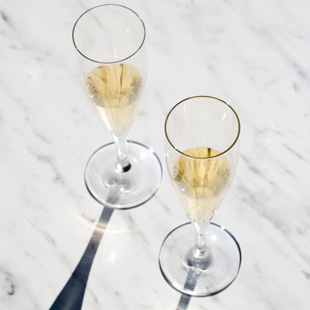 Set of champagne glasses on the table Free Photo