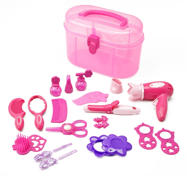 Set of children's toy for girls game hairdressing kit for girls isolated on white Premium Photo