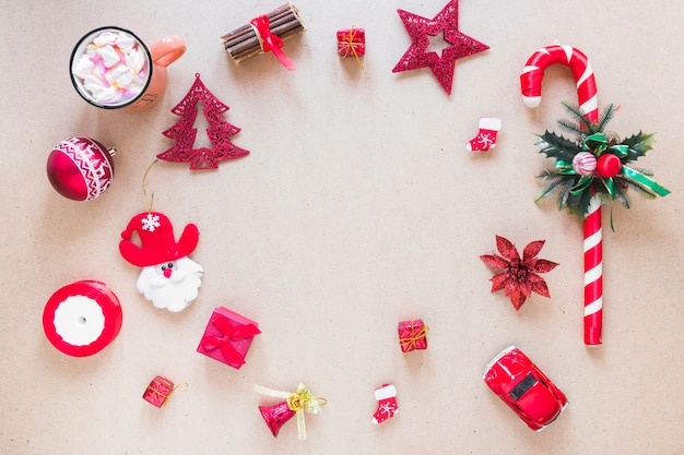 Set of christmas decorations near cup Free Photo