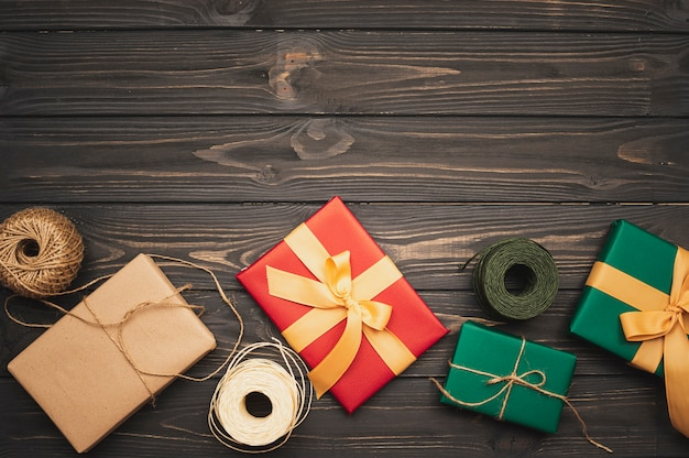 Set of christmas gifts with ribbon and string Free Photo