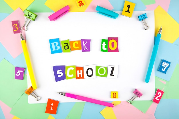 Set of colorful pens, sticky notes, notepads, pens, binderclips. top view. back to school Premium Photo