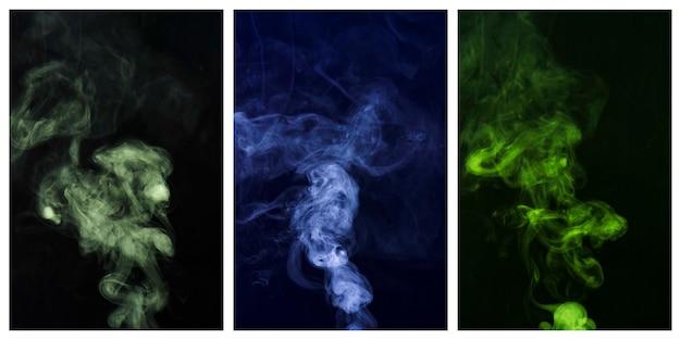 Set of colorful smoke swirling around against black background Free Photo