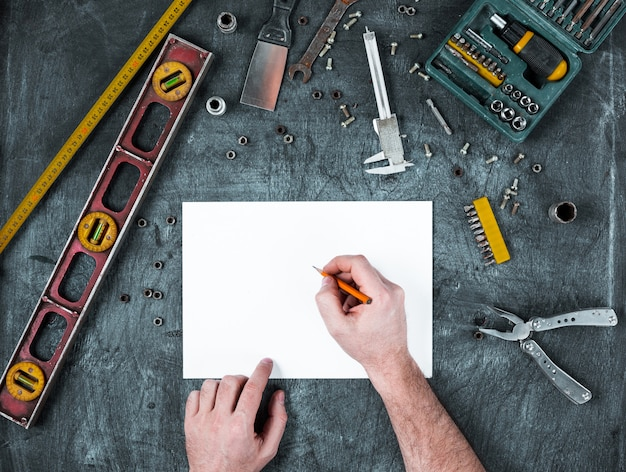Set of construction tools on wooden table Free Photo