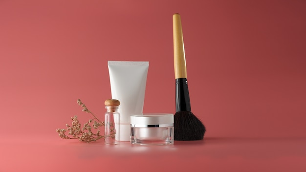 Set of cosmetic products on a color background. Premium Photo