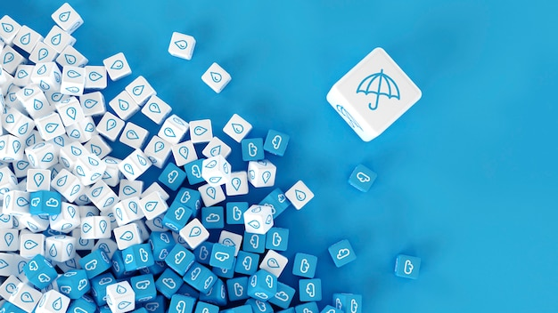 Set of cubes with the image of weather phenomena scattered on a surface Premium Photo