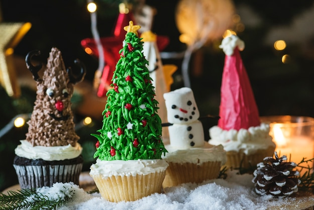Set of cute christmas cupcakes Free Photo