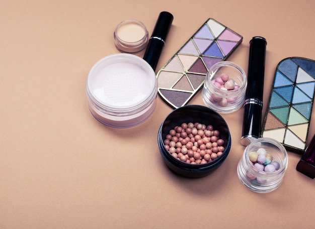 Set of decorative cosmetics on beige Premium Photo