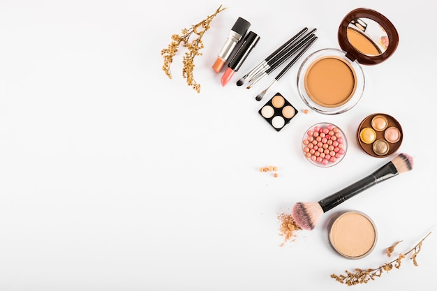 Set of decorative cosmetics and makeup brushes on white background Free Photo