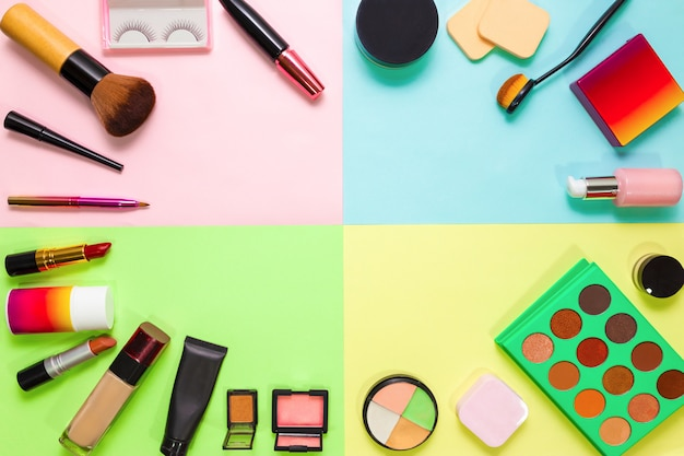 Set of decorative cosmetics, professional makeup tools brushes on color background. Premium Photo