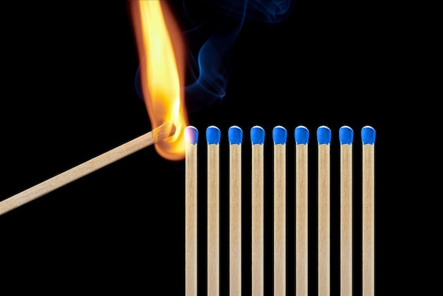 Set of different matches with smoke on a black background. concept of compliance with social distancing Premium Photo