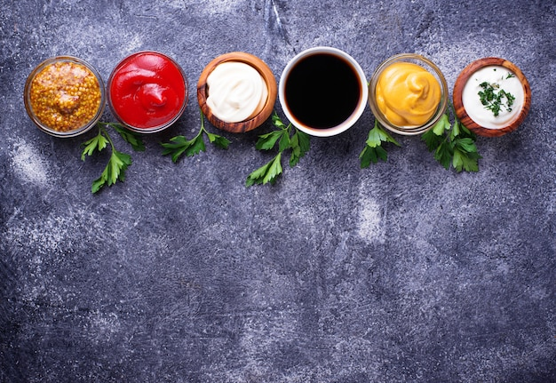 Set of different sauces and spices Premium Photo
