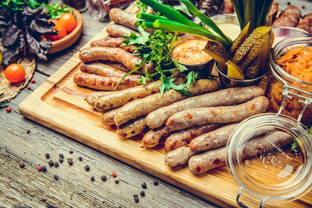 A set of different sausages, grilled on plate Premium Photo
