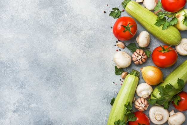 Set of different seasonal vegetables on a gray concrete background. Premium Photo