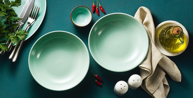 Set of empty plates on a blue table. Premium Photo