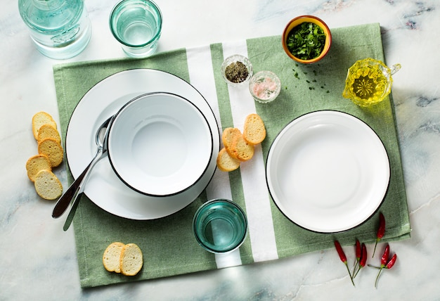 Set of empty plates on a table. Premium Photo