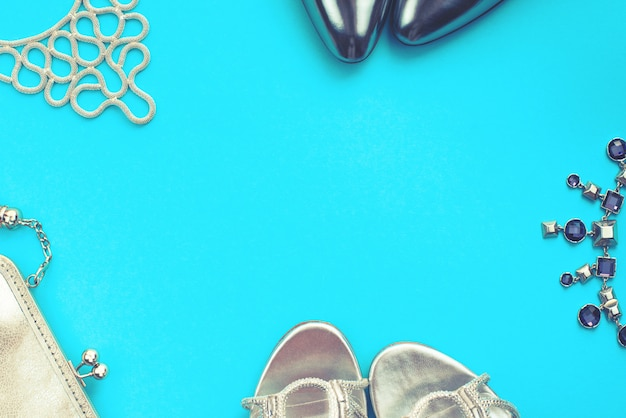 Set of fashion accessories flat lay  silver color blue background Premium Photo