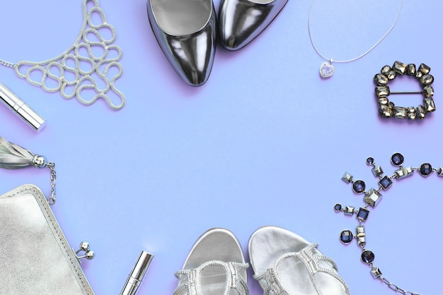 Set of fashion accessories flat lay silver color on purple background Premium Photo