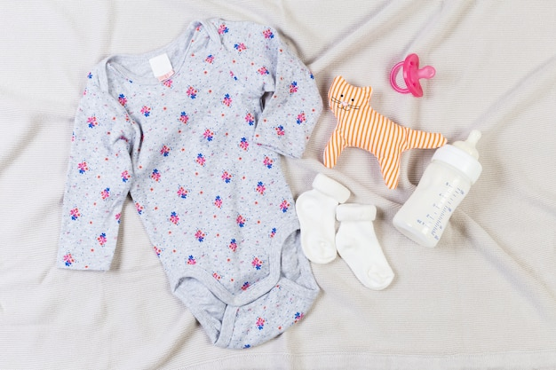 Set of fashion trendy clothes and kids stuff for little baby girl Premium Photo