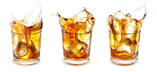 Set of glasses of whiskey with a splash Premium Photo