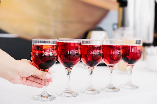 Set of glasses with alcohol on a table Free Photo