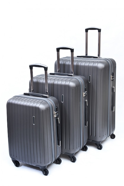 Set of gray suitcases large, medium and small isolated on white. Premium Photo