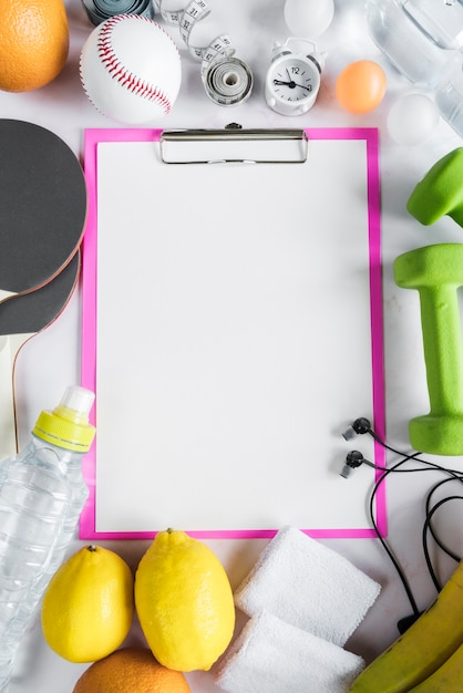 Set of healthy lifestyle objects and clipboard Free Photo