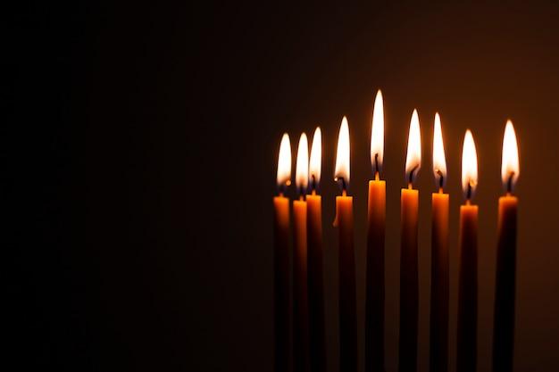 Set of holy candles burning Free Photo