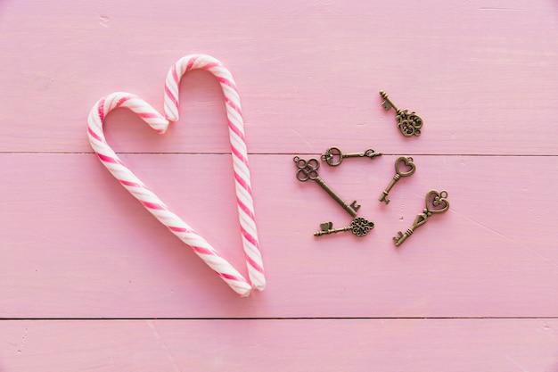 Set of keys near candy canes Free Photo