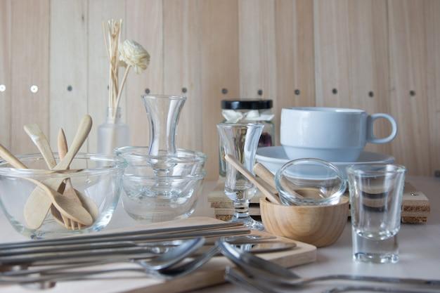 set of kitchen ware on table, kitchen utensils. photo