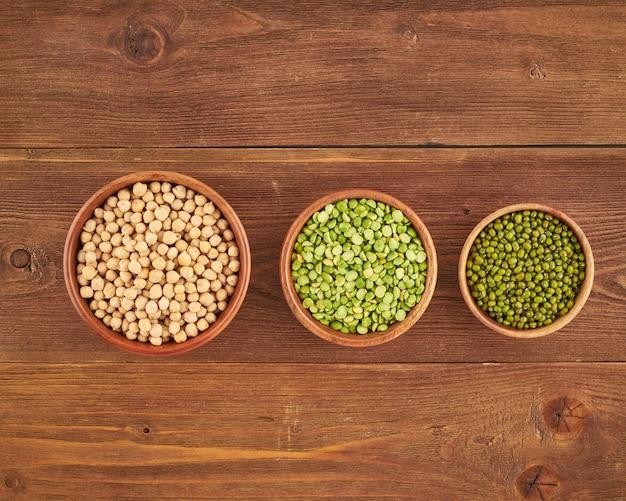 Set of legumes, beans for gluten-free protein vegan diet, green peas, chickpea, mung, top view Premium Photo