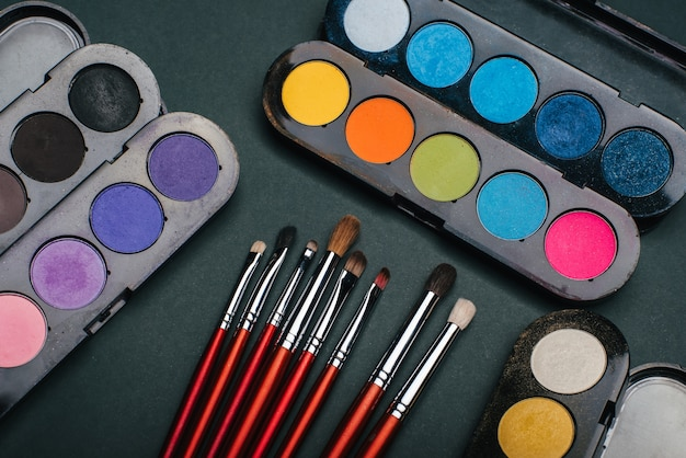 Set of makeup brushes and palette with color eye shadow Premium Photo