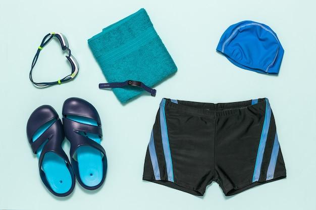 Premium Photo | A set of men's swimming accessories