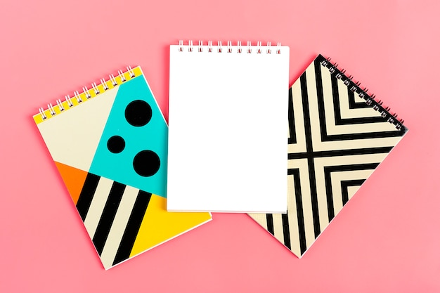 Set of notebooks for notes on pink background Premium Photo