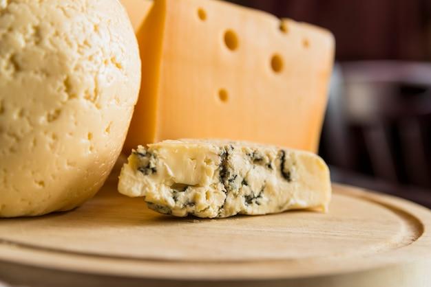 Set of fresh cheese on wood board Free Photo