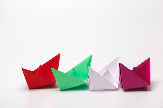 Set of origami paper boats. leadership and business concept Premium Photo