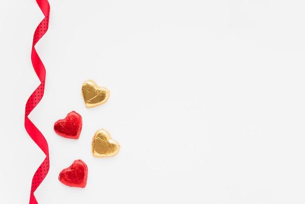 Set of ornament hearts near ribbon Free Photo