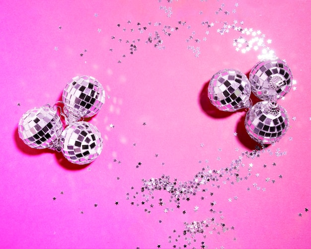 Set of ornament silver baubles near decorative stars Free Photo