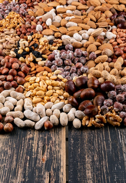 Set of pecan, pistachios, almond, peanut, cashew, pine nuts and assorted nuts and dried fruits Free Photo