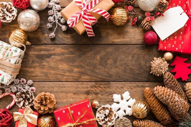 Set of present boxes in christmas wraps near ornament balls Free Photo