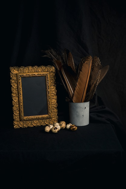 Set of quail eggs near feathers in can and photo frame Free Photo